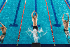 Top view of three male swimmers Stock Photo