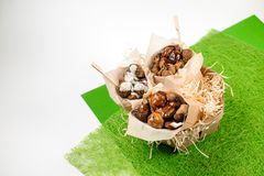 Top view of three paper packs with chestnuts arranged on green background Stock Photography