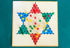 Top view of three-player board of Diamond Game. Variant of Chinese Checkers , variation of Halma strategy board game on green baize table stock photos