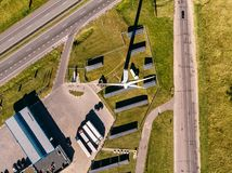 Top VIEW of three roads leading to station which generates electricity using solar panels and wind stock photography