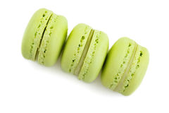 Top of view of three stacked green cake macaron  on white background, maccarone sweet dessert Royalty Free Stock Photo