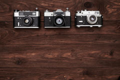Top view of three vintage cameras with a copy space Royalty Free Stock Photography