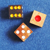 Top view of three wooden gambling dices Stock Photography