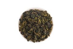 Top view of Tie Guan Yin Oolong tea in white porcelain container Royalty Free Stock Photography