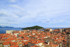 Top view of the  tile roofs and the sea in the Italian style in Dubrovnik, Croatia. Top view of the orange tile roofs and the sea in the Italian style in Stock Images