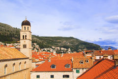 Top view of the  tile roofs and the sea in the Italian style in Dubrovnik, Croatia. Top view of the orange tile roofs and the sea in the Italian style in Stock Photos