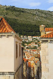 Top view of the  tile roofs and the sea in the Italian style in Dubrovnik, Croatia. Top view of the orange tile roofs and the sea in the Italian style in Stock Photography