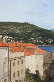 Top view of the  tile roofs and the sea in the Italian style in Dubrovnik, Croatia. Top view of the orange tile roofs and the sea in the Italian style in Royalty Free Stock Photography