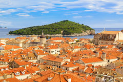 Top view of the  tile roofs and the sea in the Italian style in Dubrovnik, Croatia. Top view of the orange tile roofs and the sea in the Italian style in Royalty Free Stock Image