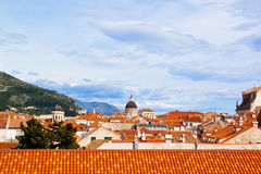 Top view of the  tile roofs and the sea in the Italian style in Dubrovnik, Croatia. Top view of the orange tile roofs and the sea in the Italian style in Stock Photo