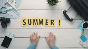 Top view time lapse hands laying on white desk word `SUMMER` decorated with travel items. Travelling concept Top view time lapse hands laying on white desk word stock footage