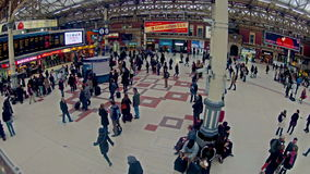 Top view timelapse of Commuters inside Victoria Railway Station in London. LONDON, UNITED KINGDOM - DECEMBER 9, 2013: Top view timelapse of Commuters inside stock video footage