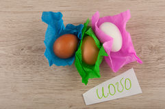 Top view title and chicken eggs in paper laying on wooden table Stock Photo
