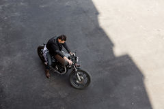 Top view to brutal man with cafe racer custom motorbike. stock photography