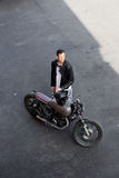 Top view to brutal man with cafe racer custom motorbike. Stock Images