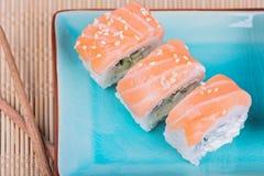 Top view to california maki sushi with salmon Stock Image