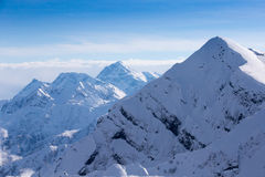 Top view to Caucasian mountains peaks covered by snow Royalty Free Stock Image