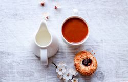 Top view to a cup of coffee and a jug of milk. royalty free stock image