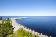The top view to embankment of Onego lake in Petrozavodsk, Karelia, Russia. The top view to embankment of Onego lake in Petrozavodsk, Karelia, Russia Royalty Free Stock Photography
