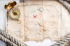 Top view to Fake treasure map with red cross and Marine rope Stock Photography