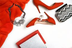 Top view to female party evening outfit red dress shoes accessories jewelry clutch fashionable necklace bracelet and box for gift. royalty free stock images