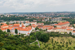 Top view to old town, historical districts and red roofs of Prague. Czech republic from an observation deck on Petrin hill Stock Photography