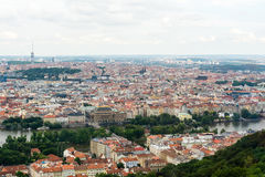 Top view to old town, historical districts and red roofs of Prague. Czech republic from an observation deck on Petrin hill Royalty Free Stock Photos