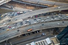 Top view to part of city road network. Multi level traffic junction royalty free stock images