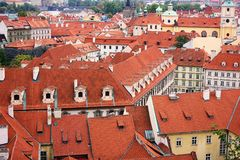 Top view to red tile roofs of Prague city Czech republic. Typical Prague houses royalty free stock photo