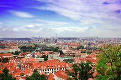 Top view to red tile roofs of Prague city Czech republic. Typical Prague houses. Wide angle panorama Stock Photo