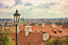 Top view to red tile roofs of Prague city Czech republic. Typical Prague houses stock images