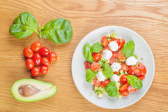 Top view to the salad with avocado and tomatoes Royalty Free Stock Photography