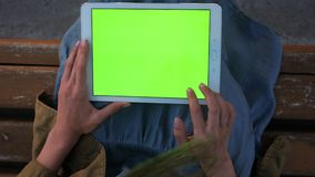 Young woman holding tablet in hands doing swiping tapping gestures. stock footage