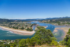 Top view to Tairua town and river, Coromandel peninsula, New Zealand. View from Mt Paku to Tairua town and river falling into the ocean Royalty Free Stock Images