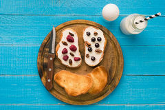 Top view of toast bread butter and berries Royalty Free Stock Images