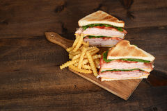 Top view toasted chicken club sandwich. On cutting board stock photography