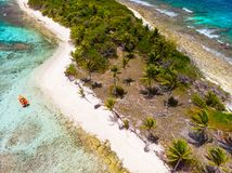 Top view of Tobago cays. Aerial drone view of tropical islands and turquoise Caribbean sea of Tobago cays in St Vincent and Grenadines stock photo