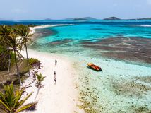 Top view of Tobago cays. Aerial drone view of Petit Tabac tropical island, turquoise Caribbean sea of Tobago cays, and a family with kids in St Vincent and royalty free stock images