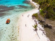 Top view of Tobago cays. Aerial drone view of Petit Tabac tropical island, turquoise Caribbean sea of Tobago cays, and a family with kids in St Vincent and stock photo