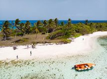Top view of Tobago cays. Aerial drone view of tropical islands, turquoise Caribbean sea of Tobago cays, and a family with kids in St Vincent and Grenadines royalty free stock photo