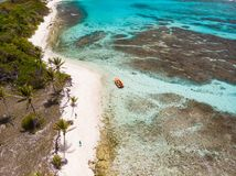Top view of Tobago cays. Aerial drone view of tropical islands, turquoise Caribbean sea of Tobago cays, and a family with kids in St Vincent and Grenadines stock photos
