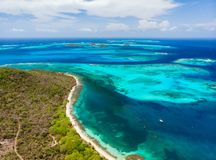 Top view of Tobago cays. Aerial drone view of tropical islands and turquoise Caribbean sea of Tobago cays in St Vincent and Grenadines stock image