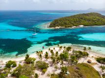 Top view of Tobago cays. Aerial drone view of tropical islands and turquoise Caribbean sea of Tobago cays in St Vincent and Grenadines stock photography