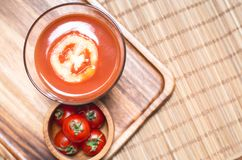 Top view of tomato juice smoothie and tomato vegetables on wooden board. Beverage for healthy and refreshment Royalty Free Stock Photography