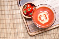 Top view of tomato juice smoothie and tomato vegetables on wooden board. Beverage for healthy and refreshment Stock Image