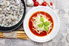 Top view of tomato soup and agaricus mushroom Stock Photos
