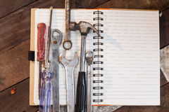 Top View tool and Notebook as Copy Space Workshop Stock Images