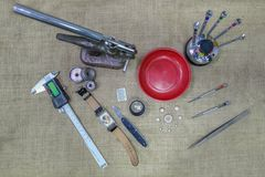 Equipment view of tools necessary for a watch battery change. Top view of tools and equipment used to change a watch battery stock images