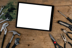 Top view of tools. With white blank tablet on wooden desk royalty free stock photography