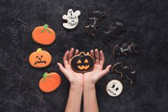 Woman holding halloween cookie Stock Photo